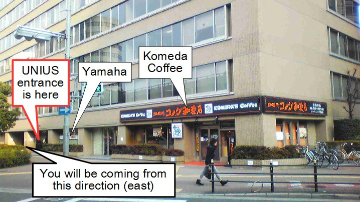 See Komeda Coffee on corner as viewed from west